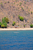 Malawi; Northern Region; Mountain landscape on the coast near Ruarwe; sparsely populated; lonely house on the beach; a fishing boat is anchored off the coast