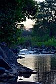 Malawi; Central Region; Bua River at dusk; near the Rafiki Safari Camp; on the edge of the Nkhotakota Wildlife Reserve