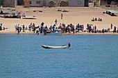 Malawi; Northern Region; Malawi lake; Usisya harbor; fisherman with dugout boat sails off the coast