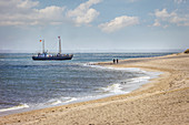 Former fishing trawler used as an excursion boat in front of the Ellenbogen nature reserve near List, Sylt, Schleswig-Holstein, Germany