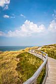Wooden boardwalk on the cliff near Wenningstedt, Sylt, Schleswig-Holstein, Germany