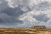 House balaclava with rain clouds near Kampen, Sylt, Schleswig-Holstein, Germany