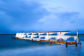 Bathing jetty with icicles at the blue hour, Baltic Sea, Heiligenhafen, Ostholstein, Schleswig-Holstein, Germany