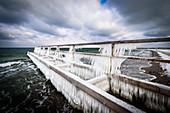 Icy bathing jetty in Heiligenhafen, Baltic Sea, Ostholstein, Schleswig-Holstein, Germany