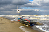 Storm day on the Baltic Sea in Dahme with boat, watchtower, SchleswigHolstein, Germany