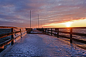 Ice on the pier in Dahme in sunrise, Baltic Sea, winter, ice, Schleswig-Holstein, Germany