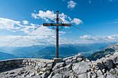 Summit cross on Hafelekar with a view of Innsbruck, Tyrol, Austria