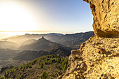 """View from the """"Roque Nublo"""" monolith in the high mountains of Gran Canaria (1813 m altitude) in the evening light, Spain"""