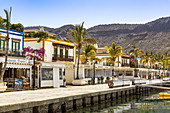 Promenade with restored colorful houses at the port of Puerto de Mogan, southwest Gran Canaria, Spain