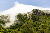 Clouds move over the mountain range in the Anaga Mountains, Tenerife, Spain