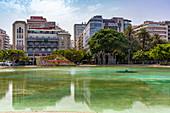 Plaza de España with artificial water and reflective buildings in the center of Santa Cruz de Tenerife, Tenerife, Spain