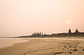 Bushfires color the sky red over Yamba in November 2019 in New South Wales, Australia.