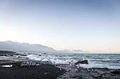 Sunset on Kaikoura Beach in the Kaikoura District in New Zealand.