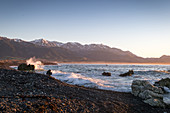 Sunrise on Kaikoura Beach in the Kaikoura District, New Zealand.