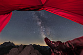 Camping under the Milky Way on a summit in the Austrian Alps