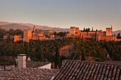 The Alhambra complex seen from Mirador de San Nicolas at sunset, Granada, province of Granada, Andalusia, Spain