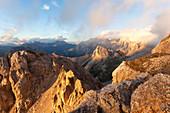 Sunset on Sas da Laste, Col Ombert and Marmolada from Banc della Campagnaccia along the Bepi Zac High Trail, Costabella Ridge, Marmolada group, Dolomites, Moena, Fassa Valley, Trento province, Trentino-Alto Adige, Italy.