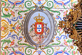 The emblem of University of Coimbra on the decorated ceiling of Capela de São Miguel (Saint Michael's Chapel), Coimbra, Coimbra district, Centro Region, Portugal.
