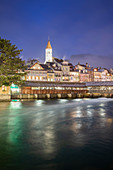 Historical center is reflected in the Aare river at dusk. Thun, Canton of Bern, Switzerland, Europe.