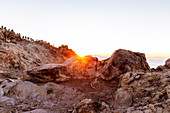 Spain,Canary Islands,Tenerife,hikers admire the sunrise from the top of Teide volcano