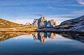 Italy,Veneto,Belluno district,Selva di Cadore,the northwest wall of mount Pelmo reflected in a small but very picturesque alpine lake
