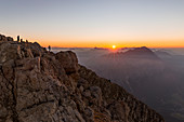 Italy,Veneto,Belluno district,Boite Valley,hikers at the top of Tofana di Mezzo admire the sunrise
