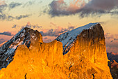 Italy, Trentino, district of Trento, aerial view of Piccolo Vernel and Punta Penia lit by the warm sunset in autumn