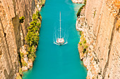 Close up of a sailing boat transiting in the narrow Corinth canal, Corinthia region, Peloponnese, Greece, Europe