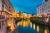 Old town and triple bridge reflected on Ljubljanica river. Ljubljiana, Osrednjeslovenska, Slovenia