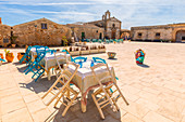 The touristic square Regina Margherita and San Francesco da Paola church in the background, Marzamemi, Siracusa province, Sicily, Italy