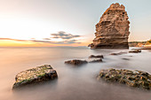 The stacks on the beach of Ciraccio at sunset\nItaly, Campania, Province of Naples, Procida