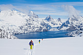 Ski touring in the fjords and landscapes of the Arctic sea in Greenland, Artic sea, Denmark