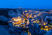 Landscape of the ancient town of Goreme at duskwith Uchisar fortrees in the background. Capadocia, Kaisery district, Anatolia, Turkey.