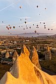 Hot air balloons in the sky of Goreme. Capadocia, Kaisery district, Anatolia, Turkey.