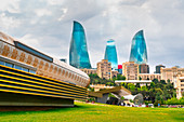 Cityscape from Baki Bulvari with Flame Towers in the background. Baku, Azerbaijan, Central Asia.