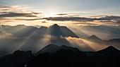 Mountain sunrise in the italian Alps during summer season. Campana peak, Valgrosina valley, Grosio, Valtellina, Sondrio district, Lombardy, Italy, Europe.