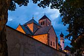 The medioeval Collegiata dei Santi Candido and Corbiniano church in the mountain village of San Candido at dusk. San Candido, Pusteria valley, Bolzano district, Dolomites, Trentino Alto Adige, Italy, Europe.