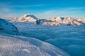 Mountainscape of Grand Combin mount over clouds from La Sale peak during winter. Igloo refuge des Pantalons Blancs, Heremence, Sion, Valais canton, Switzerland, Europe.