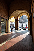 San Petronio Basilica seen from arcade of Podestà Palace, Bologna district, Emilia Romagna, Italy