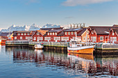 Typical red houses reflected in the sea. Svolvaer, Lofoten Islands, Norway