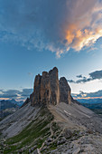 The Three Peaks of Lavaredo from Forcella Lavaredo at sunset in summer. Sesto Dolomites, Trentino Alto Adige, Italy.