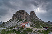 Locatelli hut with Sesto Rock and Toblin Tower at dusk in summer. Sesto Dolomites, Trentino Alto Adige, Italy.