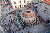 Tourists around the Jewish fountain, from an elevated point of view. Dubrovnik, Dubrovnik - Neretva county, Croatia.