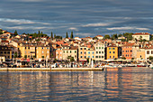 Golden glow on the houses of the old town. Rovinj, Istria county, Croatia.