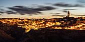 View of the Sassi quarter at dusk. Matera, Basilicata region, Italy.