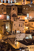 Close-up on the old houses of the Sassi quarter at night. Matera, Basilicata region, Italy.