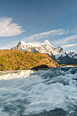 Salto Grande waterfall in the morning with Cerro Paine Grande peaks. Torres del Paine National Park, Ultima Esperanza province, Chile.