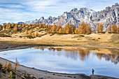 Girl near Lake Sangiatto in autumn scenery and Boccareccio peak in the background, Alpe Veglia and Alpe Devero Natural Park, Baceno, Verbano Cusio Ossola, Piedimont, Italy, Europe