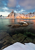 Sunrise at Hamnoya in front of Olstinden mountain, Hamnoy, Moskenes, Moskenesoya, Nordland, Lofoten, Norway, Northern Europe