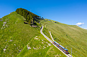Aerial view of the Monte Generoso rack railway and train. Rovio, Lake Ceresio, Canton Ticino, Switzerland.